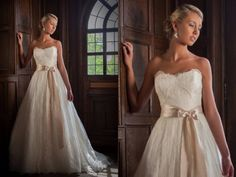 Beautiful ballgown with flowing skirt and a gold sash from Augusta Jones Fall 2014.  Augusta Jones available at Cocoa Couture Pinned from www.dreamweddingspa.com
