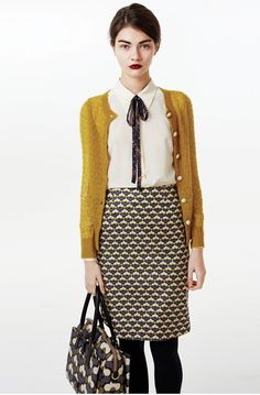 Orla Kiely white blouse with a patterned bow tie, ochre cardigan, patterned…