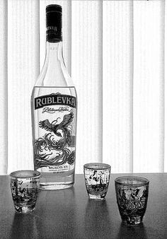 A bottle of vodka and a few drinking glasses