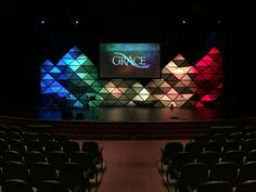 Bryan Copperthite from Grace Community Church in Fulton, MD brings us this awesome 3D, three pointed modular system. This concept was inspired by the amazing wall built by The Rock Family Worship Center back in 2013. They decided to take the concept and turn it into mountains of sorts. Materials: - 20-25 4mm 4'x8' Coroplast Sheets, mostly gray with a few white cut into 8 equal triangles - 20 rolls of extra wide Gorilla tape - Wire rope - 50' unistrut - 6 10' all thread rods to hang from…