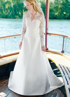 Katherine by Lea Ann Belter.  This is a gorgeous silk dupioni gown featuring a French Alencon lace bodice adorned with pearl and crystal beading.  A matching long sleeved lace jacket is pictured.  Available at Brides By The Falls, in Chagrin Falls, Ohio.
