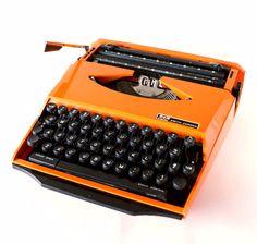 Vintage Smith Corona Karmann Ghia Super G Portable Typewriter in Orange and Black (c.1970s)