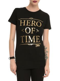 """Fitted black tee from The Legend Of Zelda with gold foil """"Hero Of Time"""" text design. Text Design, Legend Of Zelda, Hot Topic, Pop Culture, Graphic Tees, Cool Outfits, My Style, Hero, Mens Tops"""
