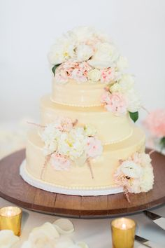 Yellow cake and soft pink florals: http://www.stylemepretty.com/little-black-book-blog/2014/09/19/shabby-chic-calamigos-ranch-wedding/ | Photography: Koman - http://komanphotography.com/