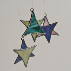 Iridescent Stained Glass Star Christmas Ornament by FiveSparrows, $8.00