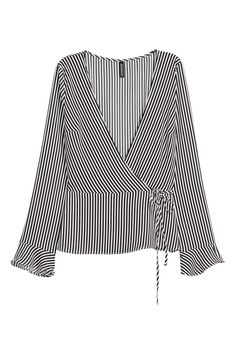 Blouse in woven crêped fabric with a low-cut V-neck. Wrapover front with narrow ties at side long sleeves with a flounce at cuffs and seam at waist with gently flared peplum. Short Tops, H&m Tops, Black White Stripes, Black Blouse, Dress Me Up, Shirt Blouses, Lady, Fashion Online, Long Sleeve Shirts