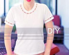 A sophisticated T Shirt makeover. This could be office appropriate with nice trousers.  DIY Cut Out T-shirt with Pearl Neck and Sleeves by Maegan Tintari