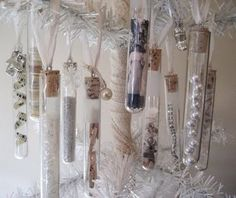 Vintage vials with glitter, beads, rhinestones, jewelry pieces, curlicues of paper strips, graphics, and cork stoppers w/small eye screws and ribbon.  (I have lots of these vials and they have screw-on tops so corks are not necessary.)