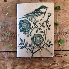 Hand printed bird & wold rose sketchbook by LouTonkin on Etsy Lino Design, Printed Portfolio, Printmaking, Moose Art, Artsy, Bird, Drawings, Unique Jewelry, Handmade Gifts