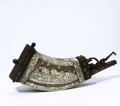 Powder flask   England 1580, Wood, inlaid with engraved staghorn; iron mounts damascened in gold and silver
