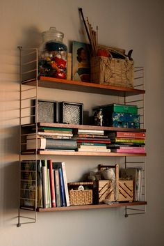 lovely ladderax. (well, it's actually String shelving, not to be pedantic, original poster)