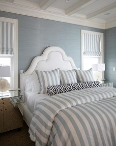 What a dreamy master bedroom! The custom upholstery features fabrics from China Seas, Thibaut and Sunbrella. Coastal Master Bedroom, Guest Bedroom Decor, Coastal Bedrooms, Guest Bedrooms, Home Bedroom, Deco Marine, Home Wallpaper, Bedroom Wallpaper, Luxury Interior Design