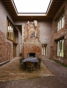 Inside five awe-inspiring 'superhouses': The dining room at Astley Castle, England, Witherford Watson Mann architects, 2013. Photo © Richard Powers.