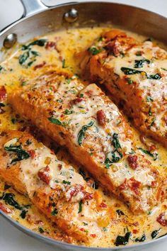 - Smothered in a luscious garlic butter spinach and sun-dried tomato cream sauce, this Tuscan salmon recipe is so easy, quick, and simple. - by Creamy Garlic Tuscan Salmon With Spinach and Sun-Dried Tomatoes - Salmon Dishes, Fish Dishes, Seafood Dishes, Seafood Recipes, Vegetarian Recipes, Chicken Recipes, Dinner Recipes, Cooking Recipes, Healthy Recipes