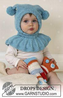 DROPS hettelue med pongponger i Alpaca og kosedyr. ~ DROPS Design - kan strikkes i dobbel babyull