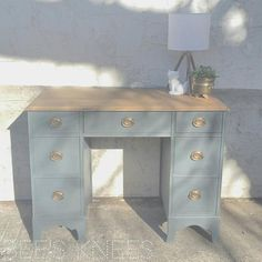 """""""Sometimes it feels so nice and therapeutic to paint something! This desk was painted with General Finishes Chalk Style Paint in Slate Gray. I refinished the top using MMS Milk Paint Antiquing Wax. Features lined drawers and original hardware."""" - Bee's Knees Be sure to swing by their place in Anoka, Minnesota!"""