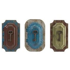 "Set of three multicolored wood designs with iron key accents.  Product: 3 Piece décor setConstruction Material: Fir wood and ironColor: MultiDimensions: 9.5"" H x 6"" W each"