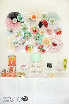 Chic Paper Rosette Backdrop Tutorial - super detailed step-by-step instructions on how to make rosettes! @How Does She