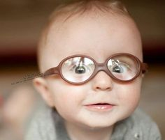 i love seeing babies in glasses. :o) maybe its because i wore glasses when i was little bitty and know that they can open up the entire world to you.