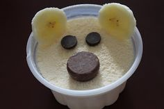 Polar bear cups for a special treat!  A regular vanilla ice cream cup, two banana slices, two chocolate chips and a Junior Mint.