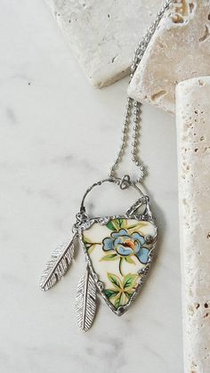 Excited to share the latest addition to my shop: Native Arrow Head-Blue Flowal-Feather Accents-Antique Plate-Broken China Jewelry-Long Sliver Chain Resin Jewelry, Glass Jewelry, Jewelry Art, Unique Jewelry, Jewelry Ideas, Arrow Head, Broken China Jewelry, Antique Plates, Mixed Media Jewelry
