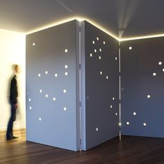 Light glows through the circular holes to give a star-studded appearance to the walls. The hinged panels are hollow and a transparent PVC pipe lines each perforation. Hidden wheels allow the partitions to be easily moved. by CUT Architectures via Dezeen (floorplans and gifs there)