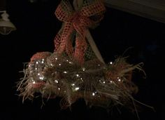 Hay Wreath Chandelier using a Twig Work Wreath, Hay, Jute Ribbons, Sprays and battery LED twinkle lights.
