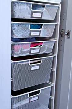 Using Martha Stewart bookplates on Elfa system to organize undergarments, work out clothes, tank tops & jeans in the closet