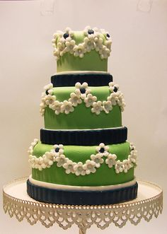 Green cake with cherry blossoms