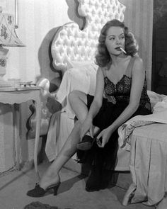 There can never be too many pictures of Jane Greer smoking in bed.