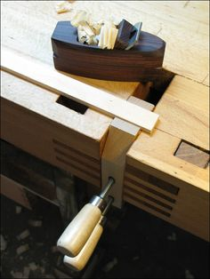 Hand-screw in a tail vice for holding stock for planing.