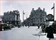 """St Giles Circus, before Centre Point.  John Somers is an excellent """"statement"""" building, with St Giles High Street to its left, and Charing Cross Road to its right.  Photographer is in Tottenham Court, approximately by the side entrance to the old Virgin Megastore."""