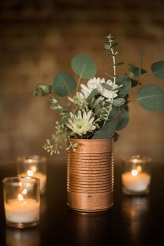 Take an urban approach and incorporate DIY industrial spray painted tin cans for. Take an urban approach and incorporate DIY industrial spray painted tin cans for your wedding centerpieces. Bronze tones are the perfect expression of modern decor! Winter Centerpieces, Simple Wedding Centerpieces, Diy Wedding Decorations, Flower Centerpieces, Centerpiece Ideas, Quinceanera Centerpieces, Diy Wedding Tables, Copper Wedding Decor, Industrial Wedding Decor