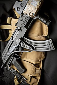 custom AK-47 assault rifle with folding stock-uncomfortable stock but its a cool pic