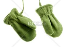 green hand gloves. - Close-up shot of green hand gloves isolated on white background.