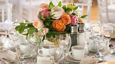 Photo by unioneleven.com Wedding Planning by ericairwin.com  At Britannia Yacht Club Ottawa Centerpiece with garden roses and peonies in blush,  corral and pink