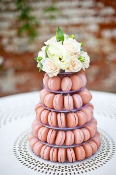 peach macaron tower wedding for a dessert #macarons #weddingdesserts #tastytreats http://www.weddingchicks.com/2013/10/30/vintage-peach-wedding-ideas/