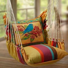 Love this padded swing..terrific colors..could be used indoors as well. There are NO DIRECTIONS but I am going to try to figure it out! TT