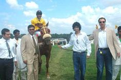 1043 Legendary (Y S Srinath up), winner of the Acrobat Plate, being led in by Racing Manager Sarosh Mody, trainer Karthik Ganapathy & owner Shapoor P Mistry (extreme right)