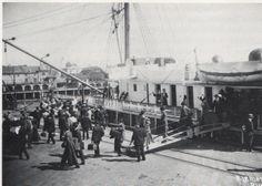 Early 1900's passengers debarking a ship at Redondo Beach Pier.