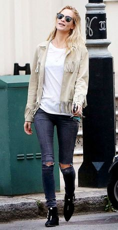 Poppy Delevingne looks impossibly cool in a fringe jacket and ripped jeans. // #Style #OutfitInspiration