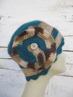 Knitted winter hats with flower detail.. https://www.etsy.com/shop/SEVILSBAZAAR