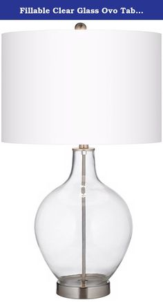 Fillable Clear Glass Ovo Table Lamp. Add a blast of designer style with this Color + Plus™ glass table lamp. The large clear glass base can be filled to suit your personal style or home decor - from decorative accessories to themed collectibles, the possibilities are endless! The lamp is topped with a crisp white linen shade and features brushed steel finish accents. Lamp base U.S. Patent # 8,899,798. - Fillable glass table lamp. - White linen drum shade. - Brushed steel finish accents. -...