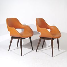 Chairs by Arthur Umanoff . These are dreamy. I feel like you could time travel to another era just by sitting in them.