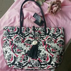 INC International Concepts, reversible tote Beautiful pink, white, roses, on tote. Large tote bag, brand new with tags, never used. Reversible tote, other  color is black. INC International Concepts Bags Totes