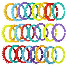 Hot 24 unids juguete mordedor bebé sonajero colorido de los anillos del arco iris cuna cama del cochecito colgantes de regalo juguetes de decoración para los niños del bebé