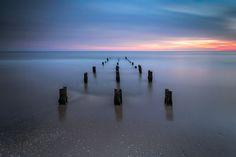 "Rule Of Thirds - These are the rests of an old pier on the beach. I was quite lucky to get a proper combination of nice sunset and low tide! :-)  I love symmetrical compositions, but I also like the rule of thirds... so I have tried to combine both of them together with a long exposure. :-)   <a href=""http://www.lucalibralato.com/"">Luca Libralato Photography</a> • <a href=""http://www.lucalibralato.com/workshops/"">Photographic Workshops</a> • <a…"