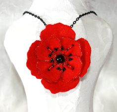 Valentines Day is just around the corner! Here is a cute hand beaded felt flower pendant necklace that would be a great accessory for night or day.  Beaded Red Flower Fabric Necklace by MysticalHeart7 on Etsy, $12.95