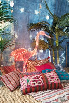 Moroccan pillows mixed with a neon flamingo... why not? Pisces dream things up for a reason! | Patina