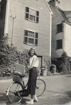 Fifties | Sylvia Plath standing beside her bicycle, Marblehead, Massachusetts, photographed by Marcia B Stern, 1951